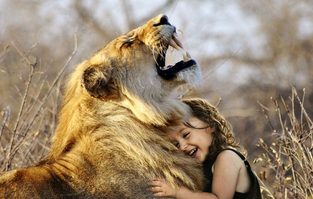 child embracing her inner lionness