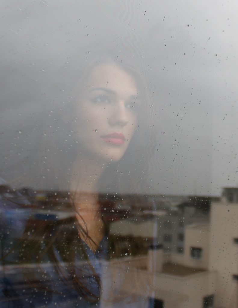 women looking thoughtfully out of window